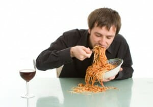 A man with eating disorder is eating noodles