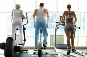 People exercising in gym