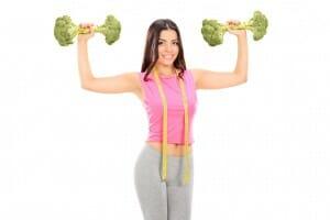 Woman holding broccoli