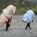 Men carrying heavy loads on back