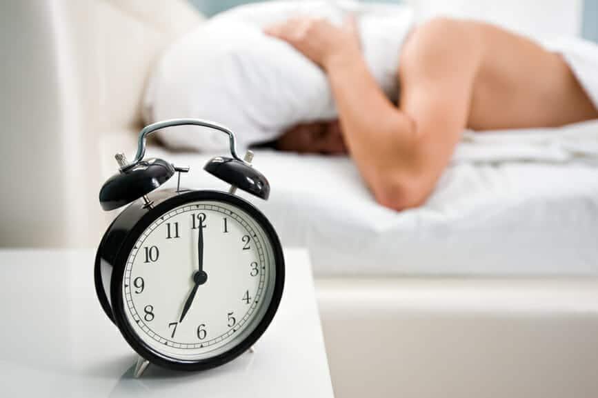 A man disturbed by his alarm clock