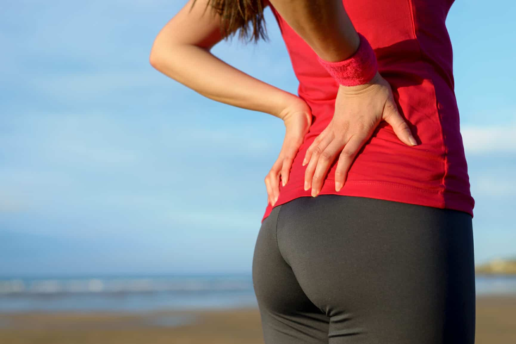 Girl with a lower back pain