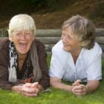 Two elderly ladies laughing