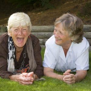 Two elderly ladies laughing