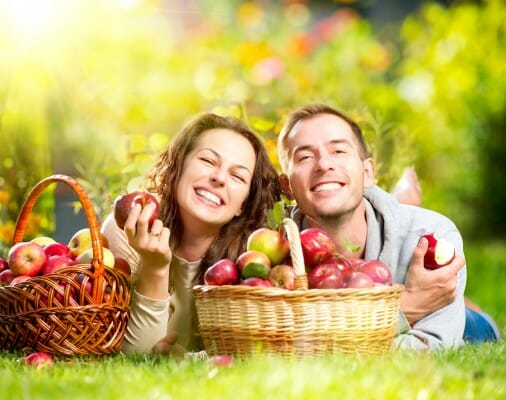 Couple enjoying eating apple