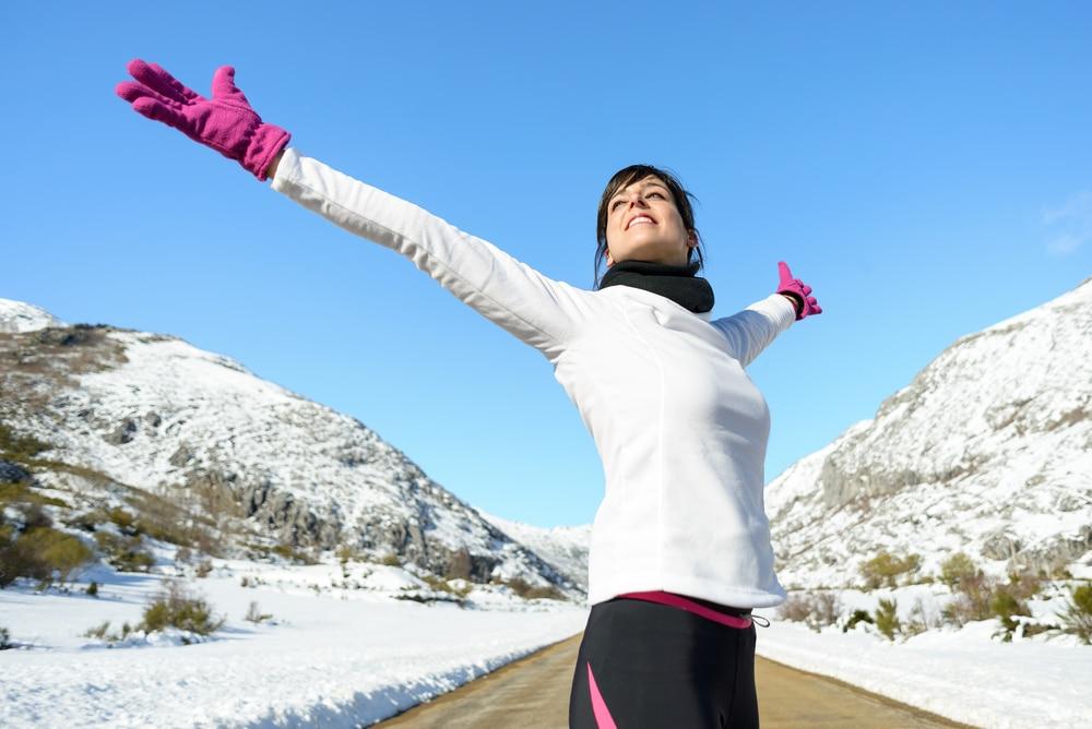 Fit woman looking happy in winter