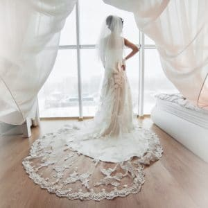Beautiful bride posing for the camera in wedding dress