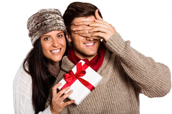 A girl giving gift to her fiance