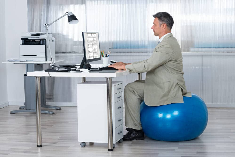 How to use an exercise ball chair plus standing desk tips healthstatus - Stability ball for office ...